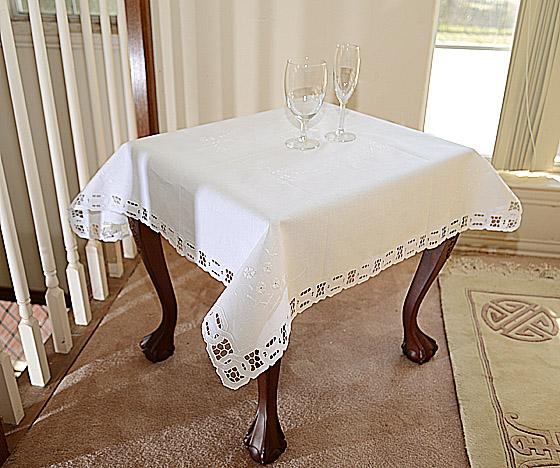 square table topper. white. cotton
