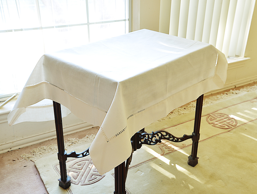 Pearled Ivory colored square Table Topper.